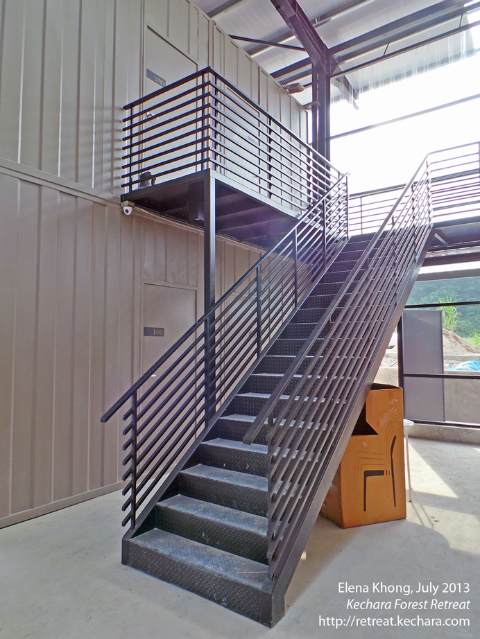 Pretty stairs in Dukkar Apartments...I love the industrial look!