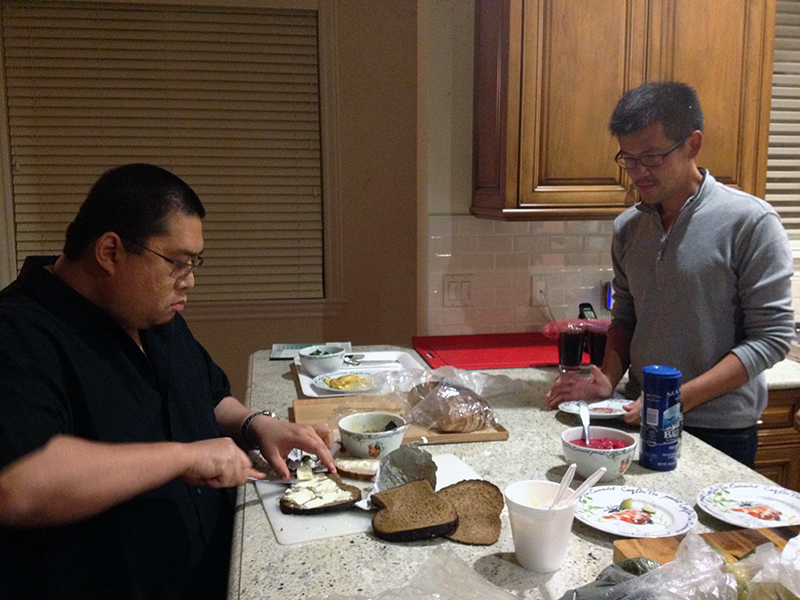 Rinpoche makes a sandwich for a student