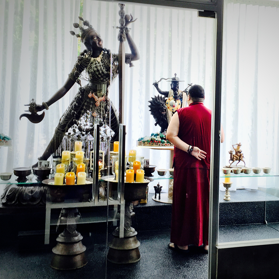 Taken in June 2015. Before going to Wisdom Hall to attend a trance of Dorje Shugden, Rinpoche stopped at his personal altar to privately speak with Dorje Shugden and make his personal requests.
