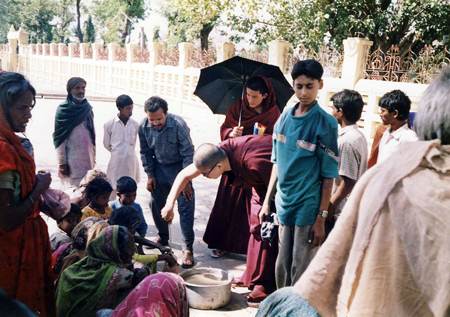 Rinpoche offering food to homeless men, women and children decades ago in India. Back then, Rinpoche had next to no money and yet still raised funds to feed the poor.