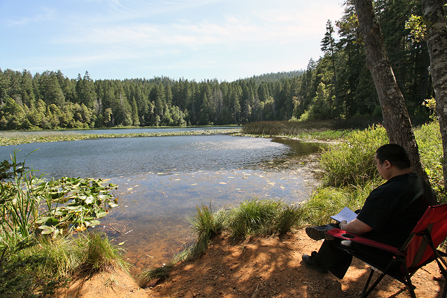 Rinpoche doing his sadhana at Fish Lake in Six Rivers National Forest (Humboldt County, North California). Rinpoche really savoured the opportunity, stopped every so often just to appreciate and take in the scene before him.