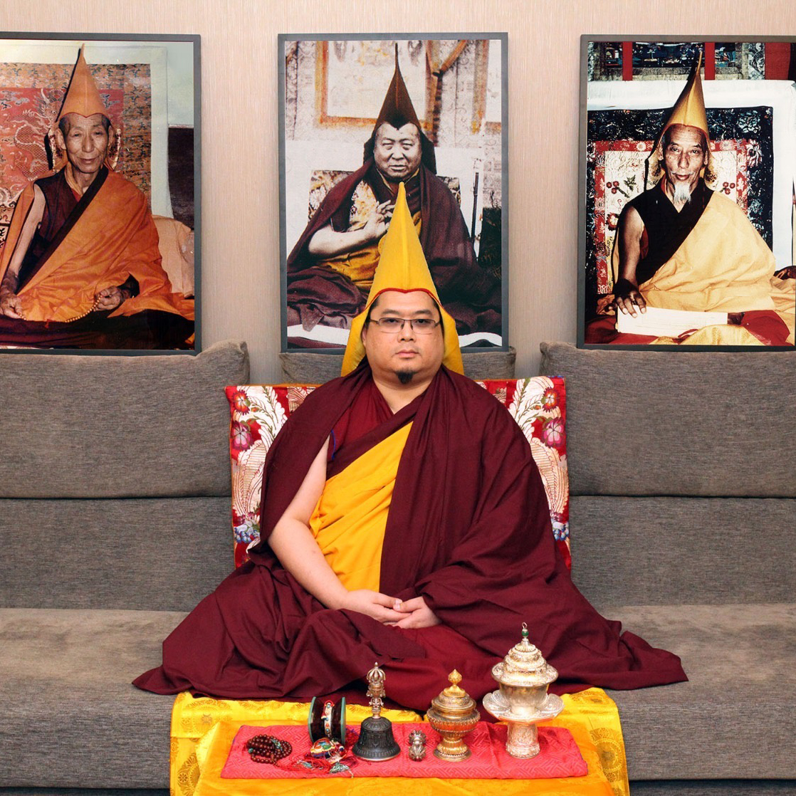 Tsem Rinpoche with portraits of His Holiness Kyabje Pabongka Rinpoche, His Holiness Kyabje Trijang Rinpoche and His Holiness Kyabje Zong Rinpoche.